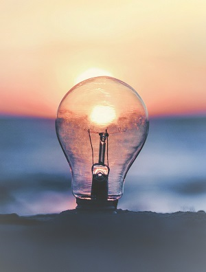 Photo of a light bulb on a beach